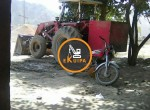 Running-stone-crusher-with-loader-and-tractor384