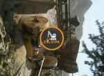 Running-stone-crusher-with-loader-and-tractor670