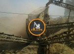 Running-stone-crusher-with-loader-and-tractor923